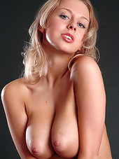 Nude model Mandy Dee holds flowers and..