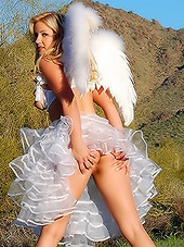 Girl outdoors in white wings looking so..