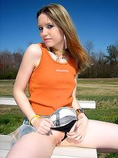 Tempting schoolgirl gets naked outdoors..