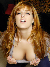 Redhead showing cleavage and covering..