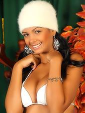 Smiling latina broad teasing in white..