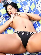 Stunning brunette honey posing on her bed