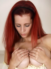 Redhead in a ruffled top is sexy and..