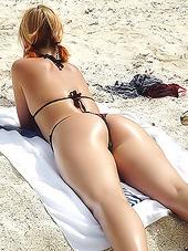 Babe in black bikini relaxing on the..
