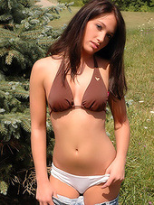 Tasty teenager in bikini is out under..