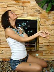 Smoking hot brunette Oleja strips nude by the fireplace
