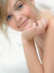 Blonde angel posing nude revealing her..