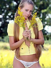 Playful blonde girl in white panties..