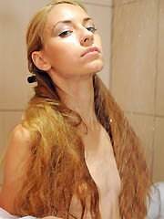Stunning teen with a splendid long hair..