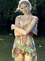 Captivating blonde blue-eyed lass has..